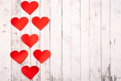 Flatlay composition with hearts on a wooden background