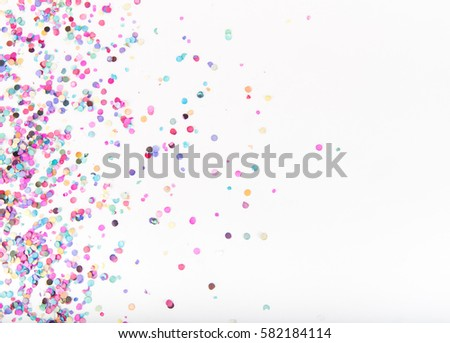 Flatlay of Colorful Round Paper Confetti on White Paper #582184114