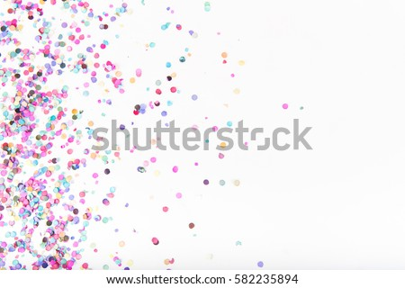Flatlay of Colorful Round Paper Confetti on White Paper #582235894
