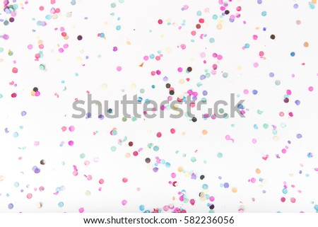 Flatlay of Colorful Round Paper Confetti on White Paper #582236056