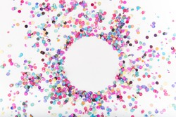 Flatlay of Colorful Round Paper Confetti on White Paper with Clear Circle in Middle