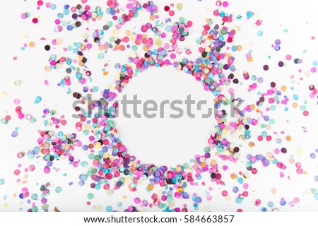 Flatlay of Colorful Round Paper Confetti on White Paper with Clear Circle in Middle #584663857