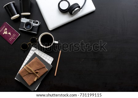 Flatlay of gadgets on black background