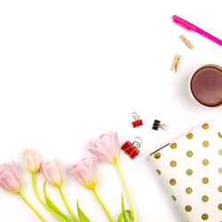 Flatlay with pink tulips, a laptop, cup of tea and other accessories. Spring business mockup, white background.