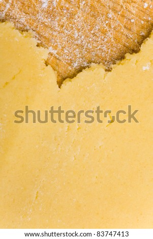 Flattened cookie dough on cutting board with flour