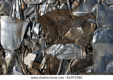 Flattened metal in recycling center