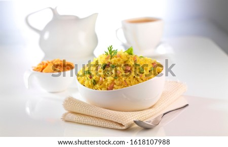 Flattened rice, commonly known poha in Hindi, is rice which is flattened into flat, light, dry flakes originating from the Indian subcontinent. Rice is parboiled before flattening so that poha can be
