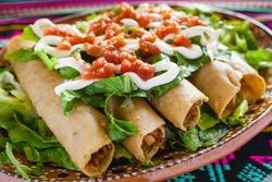 flautas de pollo, chicken tacos and spicy Salsa Homemade Mexican food in mexico city
