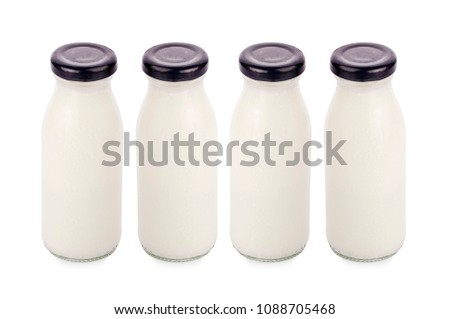 flavor of milk in bottles isolated on white background #1088705468