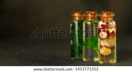 flavored oil aroma (herbs, flowers, other spices and aromas). food background. top #1453771352