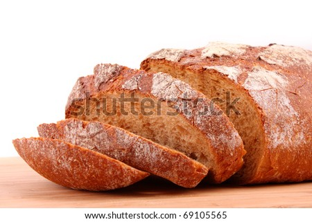 flavored sliced bread on a wooden stand isolated on white