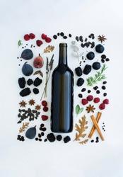 flavors of red wine flat lay, jammy red wine tasting notes - blackberry, raspberry, oak, earthy, pepper, herbs, chocolate, fig, coffee, copyspace, copy space, wine bottle mockup, mock up, blank label