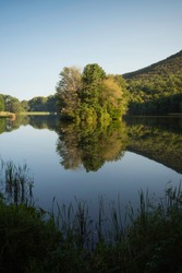 Flawless reflections of the small island at Abbott Lake with the Peaks of Otter of the Virginia Blue Ridge.