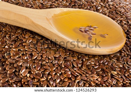 flax seed linseed and spoon oil  closeup - stock photo