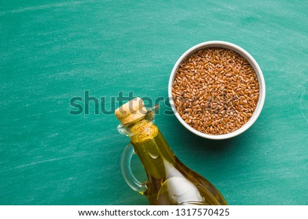 Flax seeds, linen seeds or linseeds and oil. Top view.