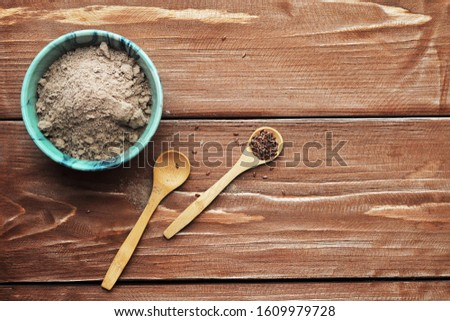 Flaxseed flour and flax grains for gluten-free baking. Healthy food, vegetarian food