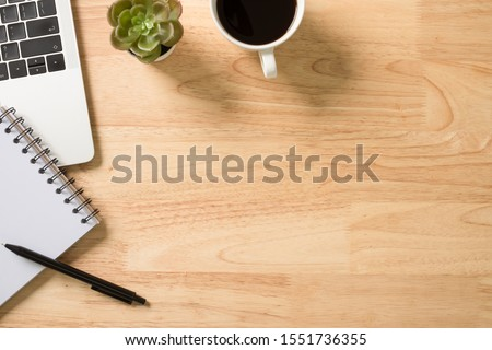 Flay lay, Top view office table desk with computer, keyboard, coffee, pen and plant with copy space background. Foto stock ©