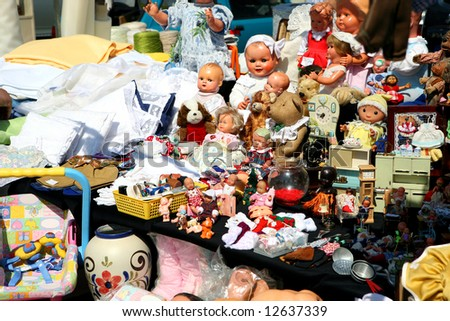 flea market booth with a huge variety of toys and dolls
