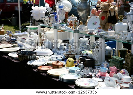 Flea Market Booth With Different Dishware On A Spring Flea Market
