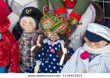 Flea market,  folk crafts. Handmade rag dolls. A rag doll is a children's toy. It is a cloth figure, a doll traditionally home-made from (and stuffed with) spare scraps of material.