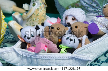 Flea market,  folk crafts. Handmade rag dolls. A rag doll is a children's toy. It is a cloth figure, a doll traditionally home-made from (and stuffed with) spare scraps of material. #1171228195