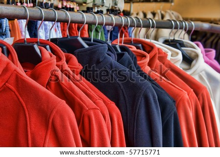 Fleece jackets hanging on clothes hangers