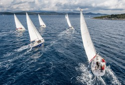 Fleet of sailing boats during offshore race from bird view