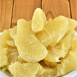 Flesh of fresh yellow pomelo on the wooden background