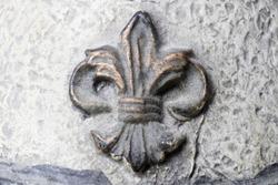 Fleur-de-lis on Antique plaster background.