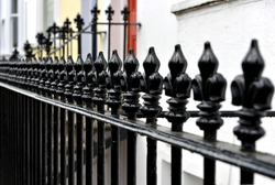 Fleur de lis railing outside Victorian houses
