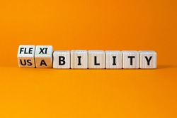 Flexibility and usability symbol. Turned wooden cubes and changed words 'usability' to 'flexibility'. Beautiful orange background, copy space. Business, flexibility and usability concept.