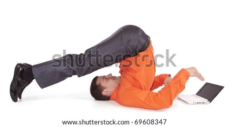 Flexible businessman with laptop computer over white background