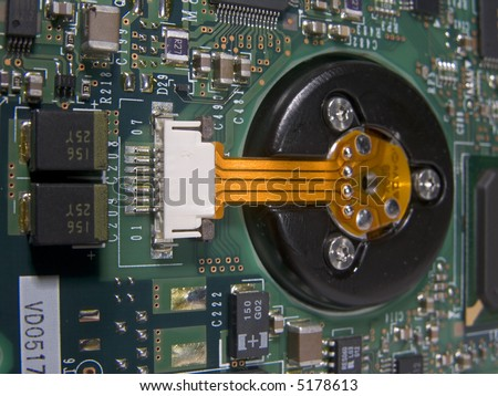 Flexible circuit connecting hard drive spindle to main circuit board.