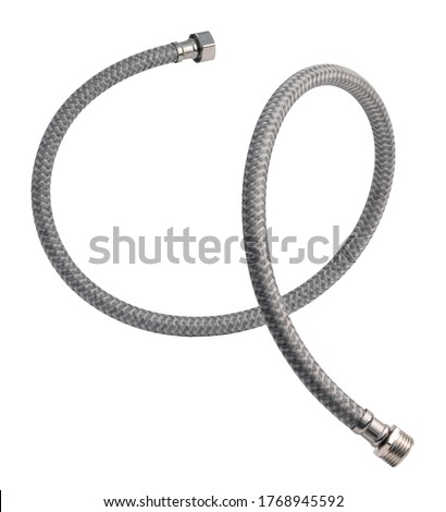 Flexible connection hose. Plumbing hose in nylon polymer braid. Isolated on a white background.