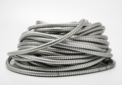 Flexible metal pipe on a white background.