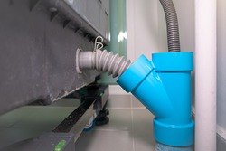 Flexible water drain pipe from washing machine and pvc pipe connector.