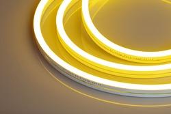 Flexible yellow led neon decor christmas light on black backgroung.