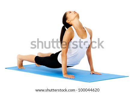 Flexible yoga woman does upward facing dog yoga pose. This is part of a series of various yoga poses by this model, isolated on white