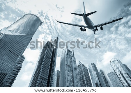 flight and modern buildings in shanghai lujiazui finance and trade zone