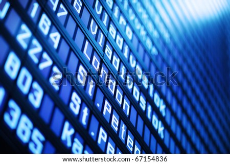 Flight arrival and departure board in airport, closeup. Abstract background.