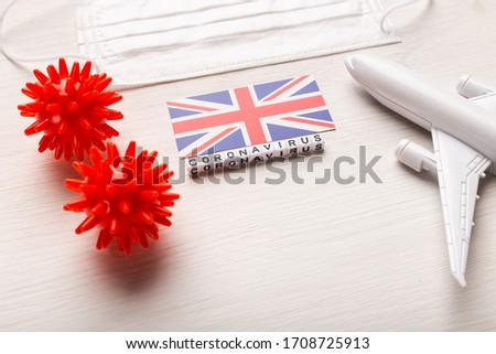 Flight ban and closed borders for tourists and travelers with coronavirus covid-19. Airplane and flag of United Kingdom on a white background. Coronavirus pandemic. Foto stock ©