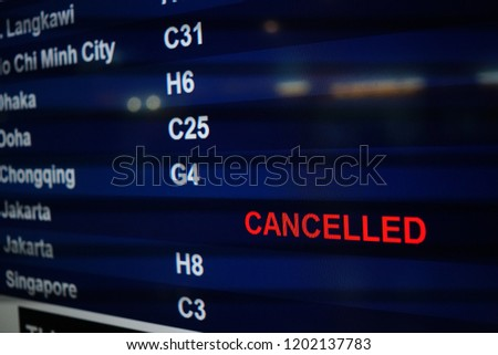 Flight Board information display on airport show flight landed, Gate Close, Delayed and cancelled.