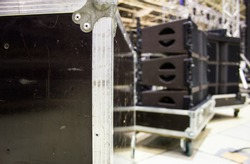 Flight case with line array speakers. Installation of professional concert sound equipment.
