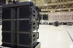 Flight cases with line array speakers. Installation of professional sound, light, video and stage equipment for a concert.