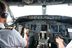 Flight Deck of small commercial aircraft.The pilots (cockpit crew) prepares for landing at the airport.