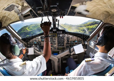 Flight Deck of small passenger aircraft.The pilots (cockpit crew) prepares for landing at the airport. #461985805