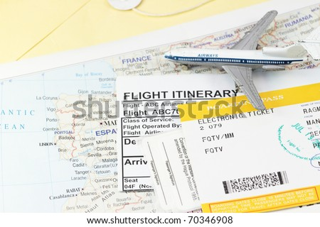 Flight itinerary with toy airplane and map abstract