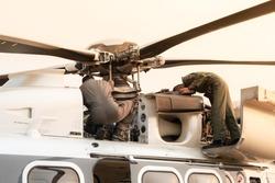 Flight maintenance inspect main rotor hub of helicopter.