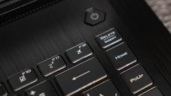 Flight mode button, F12 key, airplane button on keyboard. Laptop flat profile backlit keyboard airplane flight mode key closeup