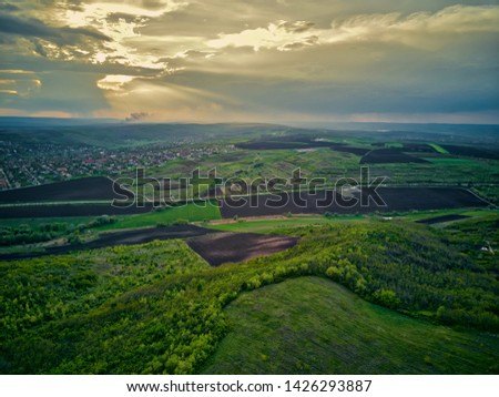 Flight over cultivating field in the spring at sunset. #1426293887
